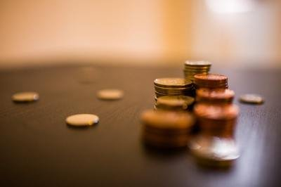 QuickBooks vs ERP - piles of coins